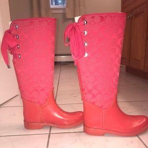 Hot pink Coach rain boots